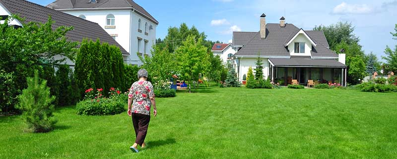woman walking on garden of a private house